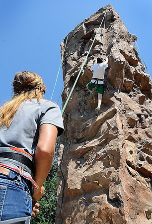 John Cross<br /> A youthful climber scales the rock climbing wall at Minnesota State University, Monday, during a rock climbing camp.