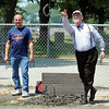 Pat Christman<br /> Minnesota Health Commissioner Ed Ehlinger plays a game of horseshoes with Watonwan County Public Health's Rich Collins Thursday in St. James. Ehlinger is visiting communities discussing public health issues over horseshoes.