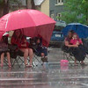 Tim Krohn<br /> A family waits through a downpour for the start of the North Mankato Fun Days parade Saturday.