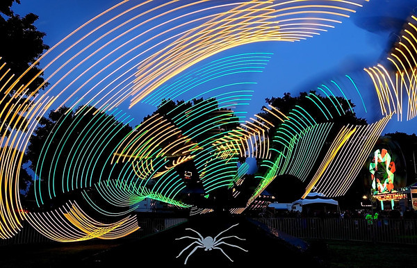 Pat Christman<br /> The lights on the Spider create a web as it twists through the night sky.