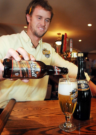 Kyle Marti of Schell's Brewery serves up Schell Shocked, a grapefruit flavored summer brew. Also pictured is Star of the North, another new beer the New Ulm brewery is brewing this summer.
