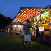 Pat Christman<br /> The games area of the North Mankato Fun Days midway is lit up for an evening's entertainment Wednesday.