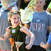 Nora Sturgis, 6, pretends to march down the street after seeing a marching band on Belgrade Avenue during the North Mankato Fun Days Parade on Saturday. Photo by Jackson Forderer