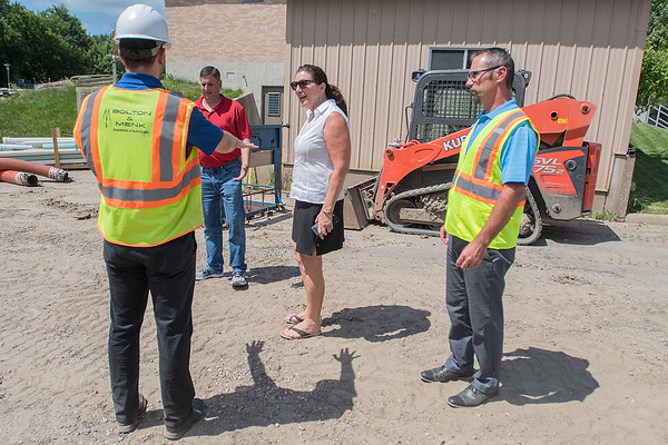 Jake Pichelmann (left), an engineer with Bolton and Menk, holds his arms out to show State Senator Julie Rosen how high the water was at the Blue Earth Waste Water Treatment Plant. Senator Rosen, along with Governor Mark Dayton and Congressmen Tim Walz visited Blue Earth on Monday to meet with local officials about what help is needed for areas affected by flooding. Photo by Jackson Forderer