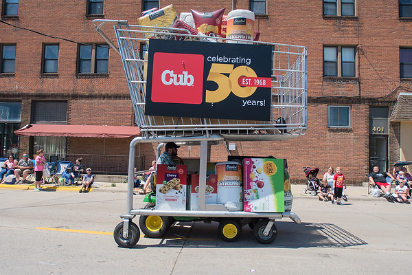 A giant Cub shopping cart model heads north on Range St. on the last leg of the North Mankato Fun Days Parade. Photo by Jackson Forderer