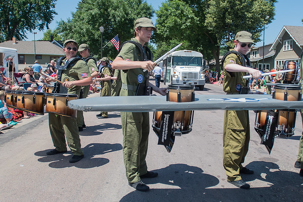 Members of Groove Inc., a drum corps from Sioux Falls, S.D., play on an extra drum extending from a replica Air Force plane on Belgrade Ave. during North Mankato's Fun Days Parade on Saturday. Photo by Jackson Forderer
