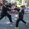 Jason Wheellock (right), 9, punches through a board held by his instructor Colby Winkler from Lee's Championship Tae Kwon Do Academy during the North Mankato Fun Days Parade held on Saturday. Photo by Jackson Forderer