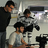 Minnesota State men's hockey player Johnny McInnis looks at video footage being recorded by Bethany Lutheran College's video production crew at last year's media day. Photo by Pat Christman
