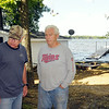 Rep. Tim Walz visits with Lake Tetonka lakeshore resident Duane Fisher who was removing sandbags from around his Waterville home as flood waters have continued to recede slowly. Photo by John Cross