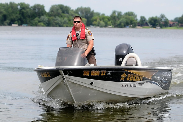 Blue Earth County Sheriff's Deputy Josh Holtz returns from a patrol on Madison Lake. Blue Earth County's proposed budget for 2015 includes funding for more staff, including a deputy sheriff who would focus on water, snowmobile and ATV patrol. Photo by Pat Christman
