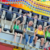 Kids enjoy themselves on a ride at the North Mankato Fun Days midway Friday at Wheeler Park. Photo by Pat Christman
