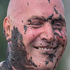 Chris Kortuem, from the Mankato Area, moments after crossing the finish line at the Warrior Dash held in rural Le Sueur on Saturday. A group of nine Kortuem cousins from Cleveland, Madison Lake and Mankato completed the obstacle course together that included ropes obstacles and a mud crawl under barbed wire. Photo by Jackson Forderer