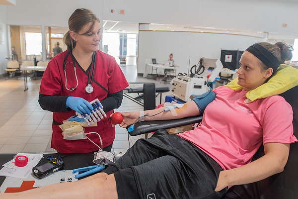 Laura Radloff (left) talks with Caulina Pape while she donated blood at the Red Cross Blood Drive held at Snell Motors on Thursday. Pape said she tries to donate blood often. Photo by Jackson Forderer