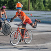 Tony White from Madison, Wisc. watches the ball fly through the air during a game of bike polo at the Dynamic Duos tournament on Saturday. Each duo in the tournament was encouraged to wear costumes and White and his teammate Nick Dellwo wore the infamous Dumb and Dumber tuxedos. Photo by Jackson Forderer