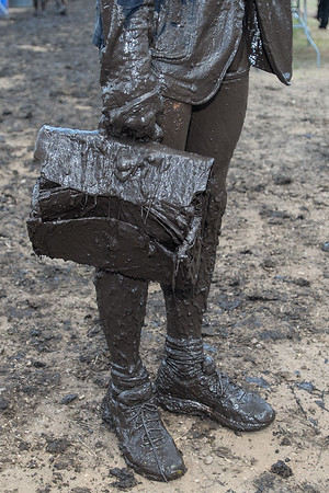 "Grant Wood from Andover, Minn. carried a brief case with him along the Warrior Dash course on Saturday. Wood said he carried the briefcase to push himself and added ""I just put it into my teeth when I needed to use my hands."" Photo by Jackson Forderer"