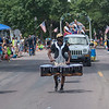 Drummers with River City Rhythm walk along the Fund Day Parade route on Belgrade Ave. on Saturday. Photo by Jackson Forderer