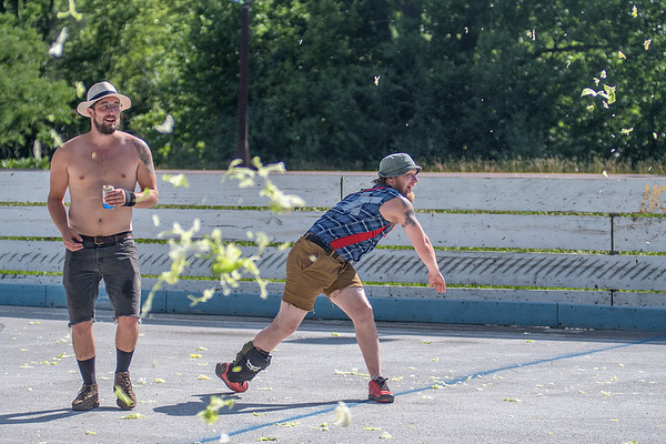 Pat Morris (right) and Joe Herke play in a game of lettuce dodgeball between games of bike polo at the Dynamic Duos tournament on Saturday. The laid back game replaced dodgeballs with heads of iceberg lettuce and a sweep of the court cleared the shreds of lettuce before the next bike polo game began. Photo by Jackson Forderer