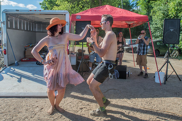 Julia Hamann and Asher Giersdorf dance to music played by the Bee Balm Fields outside of the bike polo court during the Dynamic Duos tournament on Saturday. In addition to the bike polo action on the court, participants enjoyed music and food and drink. Photo by Jackson Forderer