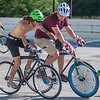 Taylor Johnson (left) and Tyler Koehler jostle for position while trying to get possession of the ball during a bike polo game at the Dynamic Duos tournament held this last weekend. Players from as far as Seattle and Canada came to the tournament hosted by the Mankato Bike Polo Club. Photo by Jackson Forderer