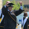 Dutch Claybaugh celebrates while walking off stage during the Gustavus commencement ceremony held at Hollingsworth Field on Saturday. Photo by Jackson Forderer