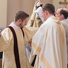 John Hayes has his robe put on for the first time at a diaconate ordination at the Cathedral of the Holy Trinity in New Ulm on Saturday. Hayes is a graduate of New Ulm Cathedral. Photo by Jackson Forderer