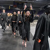 A Mankato East graduate holds up her diploma in excitement as the graduating class of 2019 exited Bresnan Arena after their commencement ceremony. Photo by Jackson Forderer