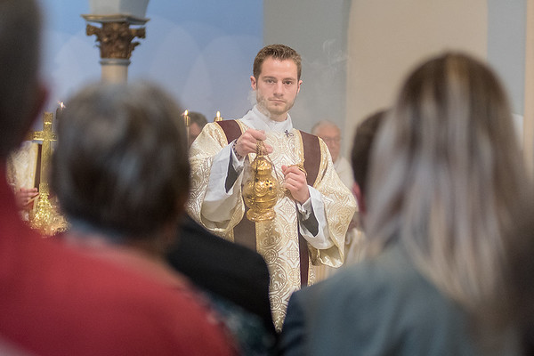 John Hayes swings a censer in front of the congregation at the Cathedral of the Holy Trinity in New Ulm on Saturday following a diaconate ordination. Photo by Jackson Forderer