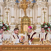 John Hayes (second from left) assists Bishop John M. LeVoir (second from right) with communion during mass at the Cathedral of the Holy Trinity in New Ulm following a diaconate ordination. Photo by Jackson Forderer