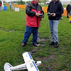 North Mankato Electric Flyers member Mike Stott goes over the controls with Matt Cherney, 16, before Cherney's first flight at the dedication of the club's new field, Forsberg Field, Saturday in North Mankato. Cherney won an airplane in a drawing at the North Mankato Taylor Library.