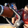 "Krista Thornes holds her son David Piotrowski, 4, as he looks through a telescope at the planet Venus as it passes in front of the Sun Tuesday at Minnesota State University. The planet will not cross the Sun, called a transit, again until 2117. For more photos go to  <a href=""http://www.mankatofreepress.com"">http://www.mankatofreepress.com</a>"