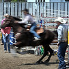 A rider bursts out of the gate during a barrel run at the Region 4 High School Rodeo Saturday at the Nicollet County Fairgrounds in St. Peter.