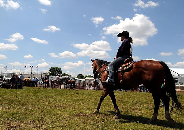 A blue sky greets a competitor and her horse as she heads toward the arena at the Region 4 High School Rodeo Saturday at the Nicollet County Fairgrounds in St. Peter.