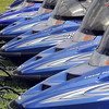 John Cross<br /> Snowmobiles to be sold at an Saturday auction are lined up at the Brown County Fairgrounds.