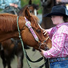 Hanna Wagner of Cambridge takes a moment with her horse Hasty before a run during the barrels competition at the Region 4 High School Rodeo Saturday at the Nicollet County Fairgrounds in St. Peter.