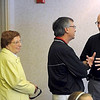 Retiring North Mankato City Administrator Wendell Sande greets visitors to an open house to celebrate his retirement Thursday.