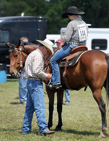John Aus gives some last minute advice to hsi daughter Dani before her barrel run at the Region 4 High School Rodeo Saturday at the Nicollet County Fairgrounds in St. Peter.