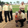 Everett Pettis, 3, waits for his father Steve and the rest of the Riverblenders to sing the National Anthem before the Mankato MoonDogs baseball team's home opener against St. Cloud Friday at Franklin Rogers Park.