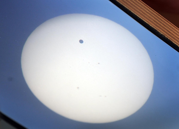 The image of Venus transitting the Sun is projected on a piece of paper outside MSU's Trafton Science Center Tuesday.