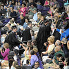Pat Christman<br /> Mankato East graduates are congratulated by family and friends as they process through the stands at Bresnan Arena during the school's commencement.