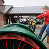 """John Cross<br /> Gus Lennartson checks out the 1917 Little Giant tractor loaned to the Children's Museum of Southern Minnesota by Denny and Carol Dotson. The tractor, part of a $500,000 donation from the Dotson Family Fund of the Mankato Area Foundation, will become part of the """"Back 40"""", and unstructured play area at the museums new location at the former city bus garage."""