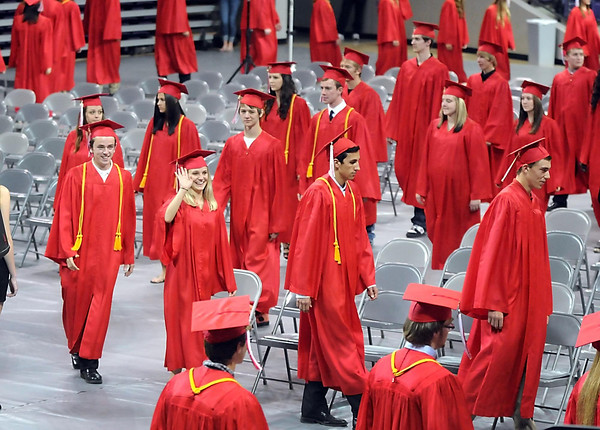 Pat Christman<br /> Mankato West senior Allie Bigbee waves to family and friends during the school's commencement ceremony Thursday at MSU's Bresnan Arena. It is the first year Mankato schools have had their commencement at the university.