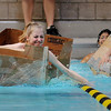 John Cross<br /> Dakota Meadows eighth grader Sarah Henry (left), gets out to an early lead in her heat as a competitor capsizes in her cardboard craft during an 8th grade team building exercise Wednesday at Gustavus Adolphus College.