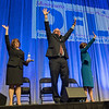 From left, Erin Murphy, Tim Walz and Rebecca wave to the audience at the DFL State Convention as the three vied for the DFL endorsement for governor. Photo by Jackson Forderer