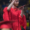 Sam Roach points to the sky after receiving his diploma. Photo by Jackson Forderer