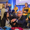 Tim Walz addresses delegates, including Chithar Vinoy (second from left) about immigration issues while campaigning on the floor at the DFL State Convention held on Saturday in Rochester's Mayo Civic Center. Vinoy is an immigrant from India herself. Walz did not earn the DFL endorsement but will compete in the primary for governor in August. Photo by Jackson Forderer