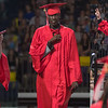 From left, Sam Roach points to the sky, Duol Luol pounds his chest after getting his diploma, a graduate does his best Richard Nixon impression. Photos by Jackson Forderer