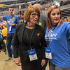 Erin Murphy, who eventually won the DFL endorsement for governor, is ushered to another section of delegates while campaigning on the convention floor at the Mayo Civic Center. Photo by Jackson Forderer