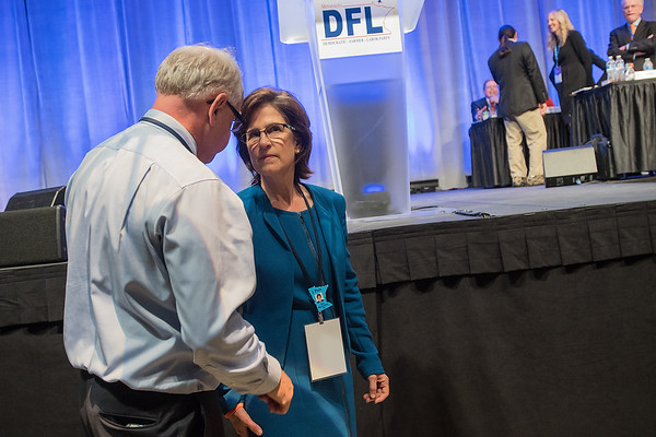 Tim Walz (left) and Rebecca Otto talk on the DFL Convention floor at the Mayo Civic Center in Rochester on Saturday. Photo by Jackson Forderer