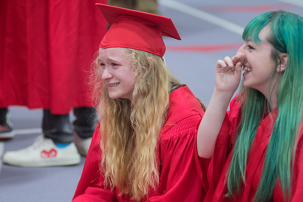 "Samantha Scholl (right) laughs while talking with Brianna Sunde (left) who was laughing and crying at the same time during what she said was ""a very emotional day,"" before the start of Mankato West's commencement ceremonies on Friday. Photo by Jackson Forderer"