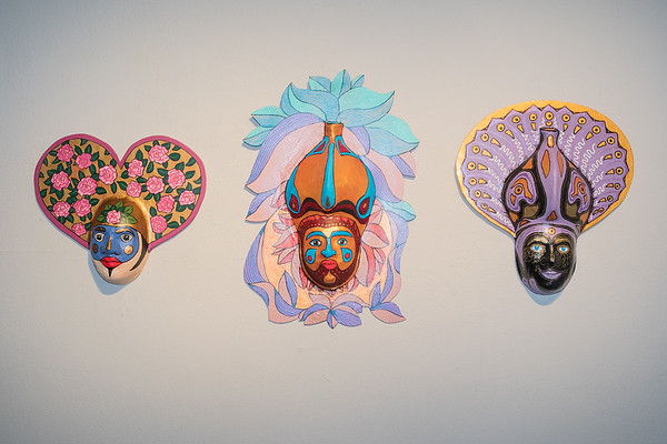 Masks made by Arnold Gruter on display at the Carnegie Art Center. Photo by Jackson Forderer